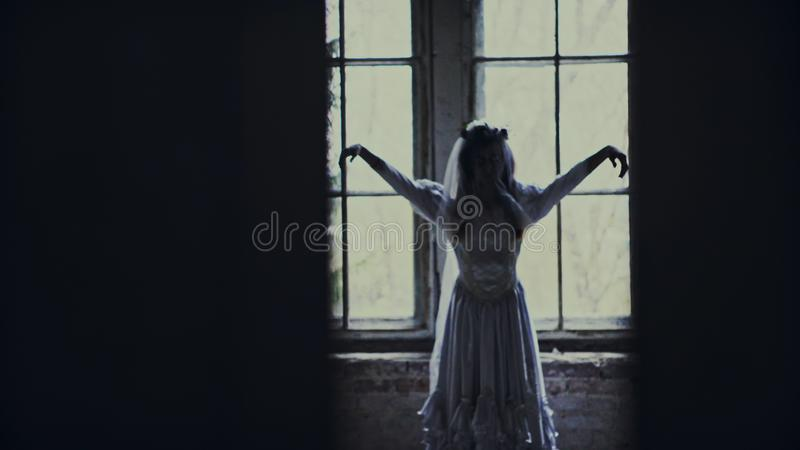 Halloween day with creepy zombie bride royalty free stock image