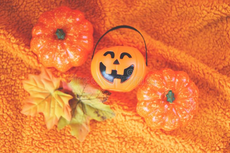 Halloween decoration accessories holiday with  pumpkin jack o lantern and leaves autumn on orange towel / halloween background royalty free stock images