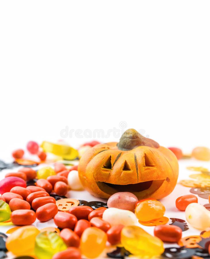 Halloween decoration concept with miniature jack-o-lantern jellybean candies isolated royalty free stock photography