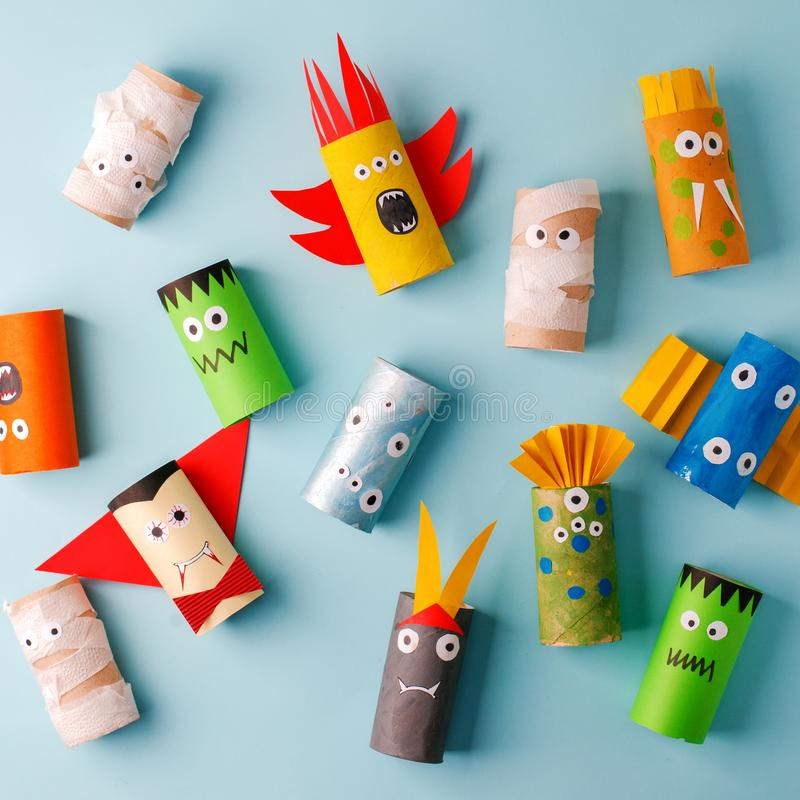 Halloween and decoration concept - monsters from toilet paper roll tube. Simple diy creative idea. Eco-friendly reuse recycle. Decor, kindergarten paper craft stock photo