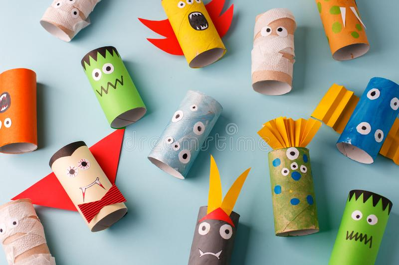 Halloween and decoration concept - monsters from toilet paper roll tube. Simple diy creative idea. Eco-friendly reuse recycle. Decor, kindergarten paper craft royalty free stock images