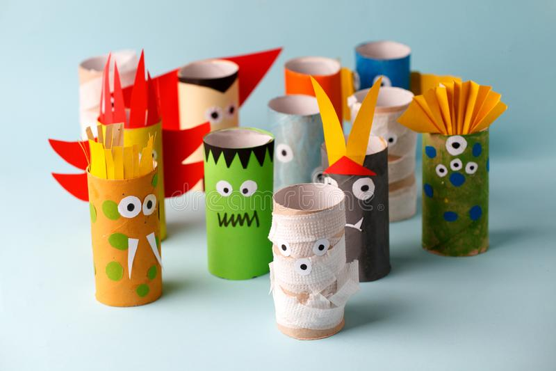 Halloween and decoration concept - monsters from toilet paper tube/ Simple diy creative idea. Eco-friendly reuse recycle decor.  stock photos