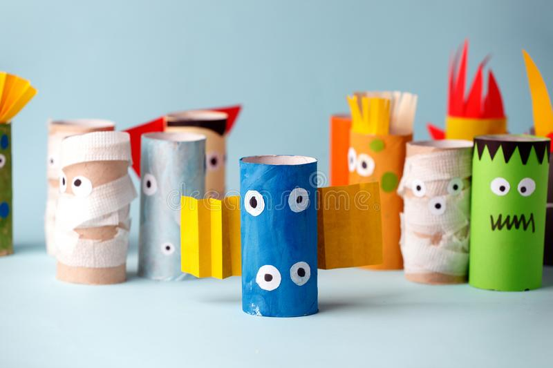 Halloween and decoration concept - monsters from toilet paper tube/ Simple diy creative idea. Eco-friendly reuse recycle decor.  royalty free stock photo