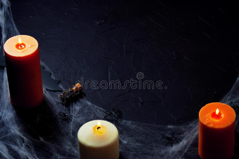 Halloween decoration with spider on web, and candles on black background. horizontal royalty free stock photos