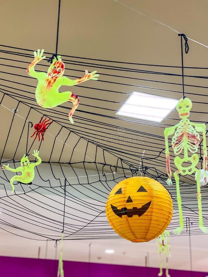 Halloween decoration with spooky jack o lantern and bloody skeleton royalty free stock photo