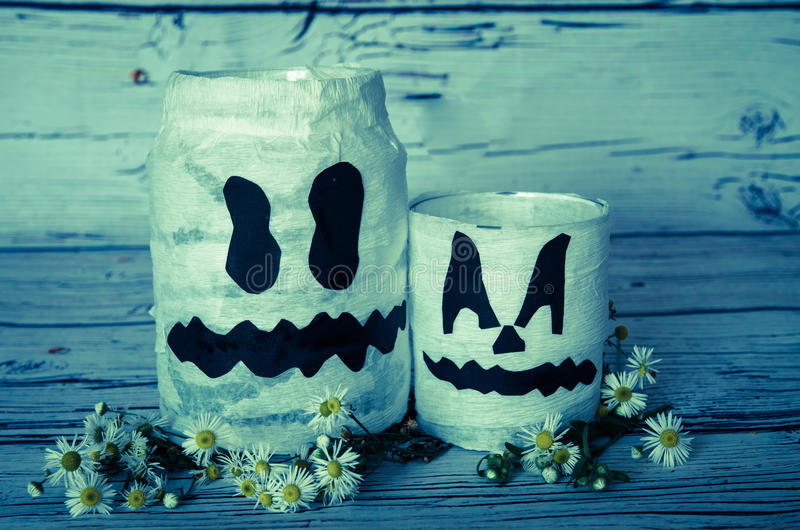 Halloween decoration. Spooky white pumpkin jar decoration royalty free stock photo