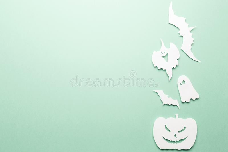 Halloween decorations. Halloween paper decorations on pastel mint background. Top view. Flat lay of accessory decoration Halloween festival. Copy space stock photography