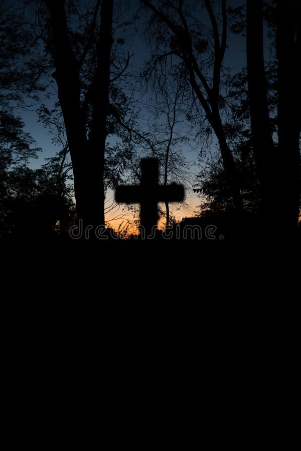 Halloween design background. Graveyard at night. Old Spooky cemetery, silhouette of crosses, minimalistic, vertical photo royalty free stock image