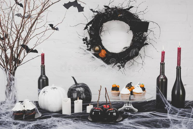Halloween desserts and decorations stock photo