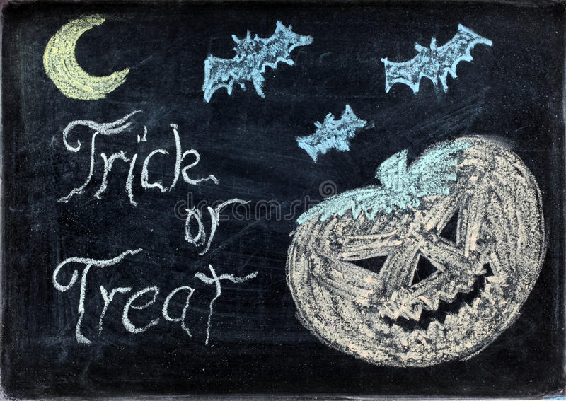 Halloween drawing. On chalkboard or blackboard with trick or treat stock photos