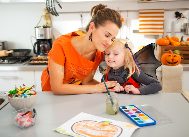Halloween dressed girl spending fun time with mother royalty free stock photos
