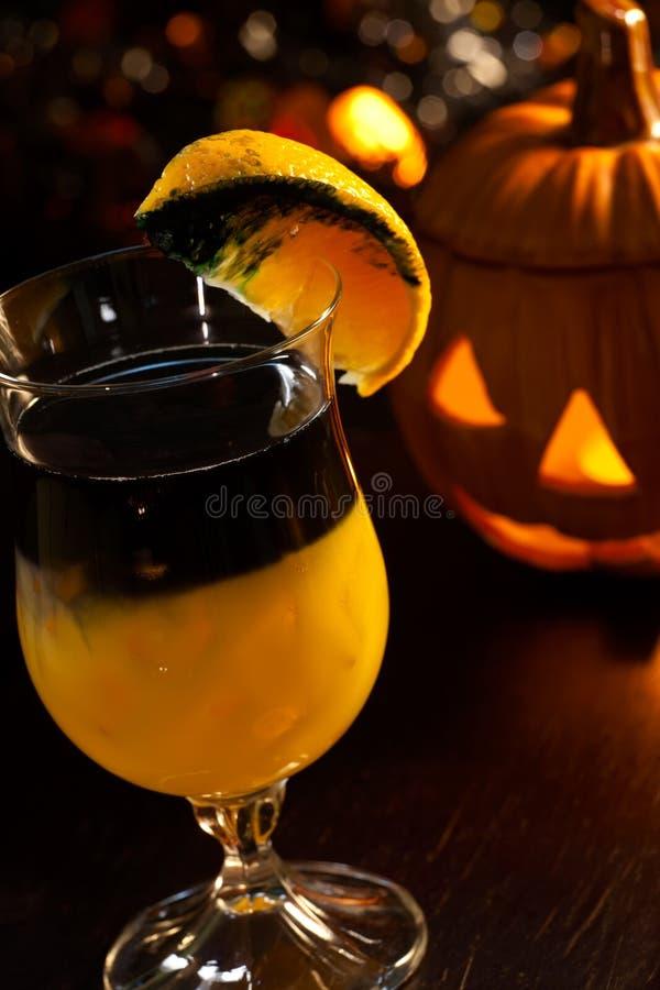 Halloween drinks - Rotten Pumpkin Cocktail royalty free stock image