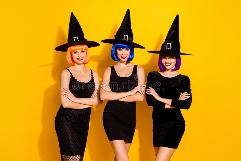 Halloween Eve concept. Photo of slim enchanting devilish haunting mysterious glamorous friends girlfriends in horror royalty free stock images