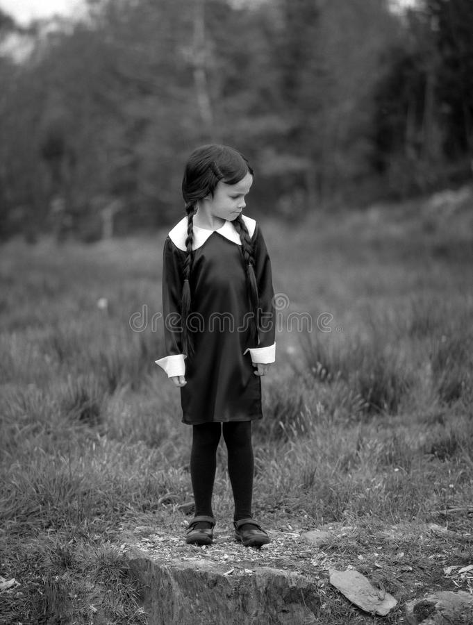 Halloween Fancy Dress. A little girl dressed up as Wednesday Addams stock photos