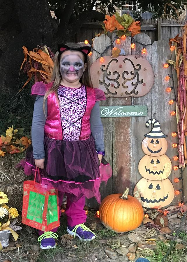 Halloween. Is a favorite holiday enjoyed by children across the country. Ghost, goblins and lots of candy to fill their bag. Pumpkins, painted faces and scary stock photo