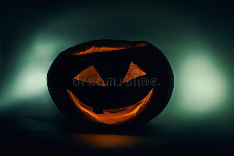 Halloween-feestpompoen met ogen het glanzen stock foto's