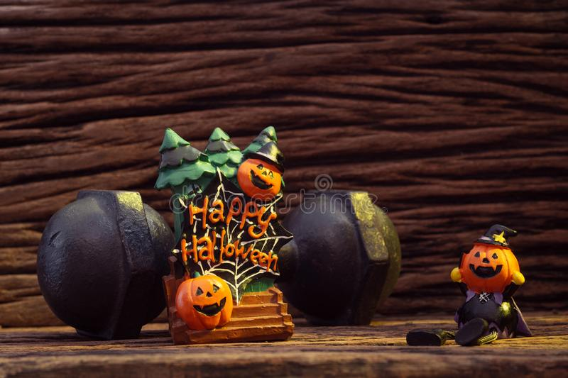 Halloween festival Head Doll Pumpkins haunted spooky and the black iron dumbbell. Fitness, healthy active lifestyle on stock images