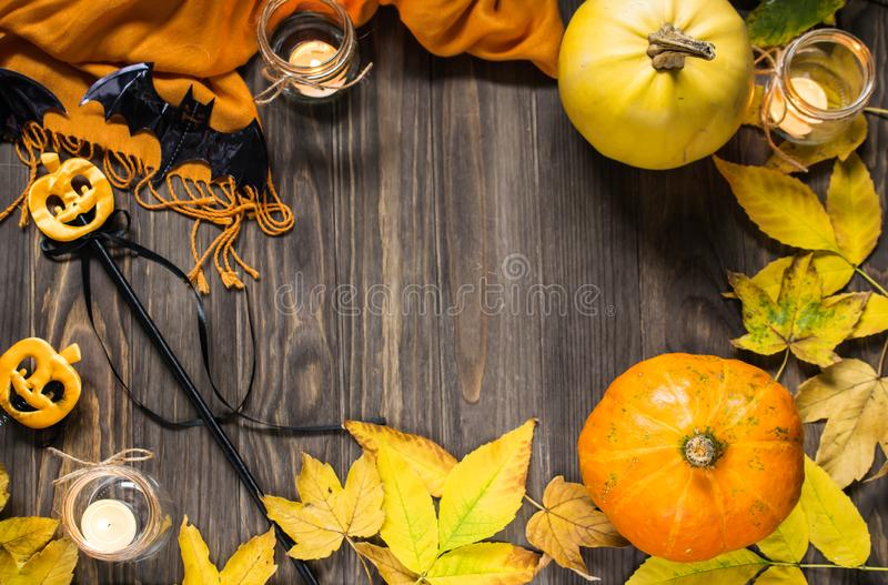 Halloween flat lay composition on wooden background with pumpkins, autumn leaves and candles stock photography