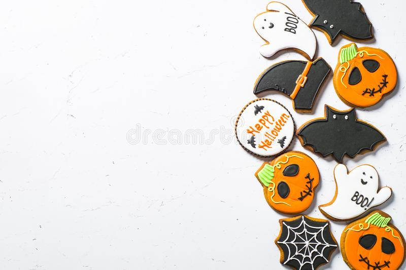 Halloween food bakground -Gingerbread Cookies on white table. stock photo