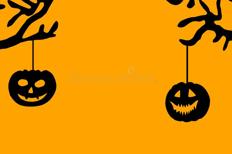 Halloween frame with jack o lantern, hanging from tree branches on orange background, copy space stock images