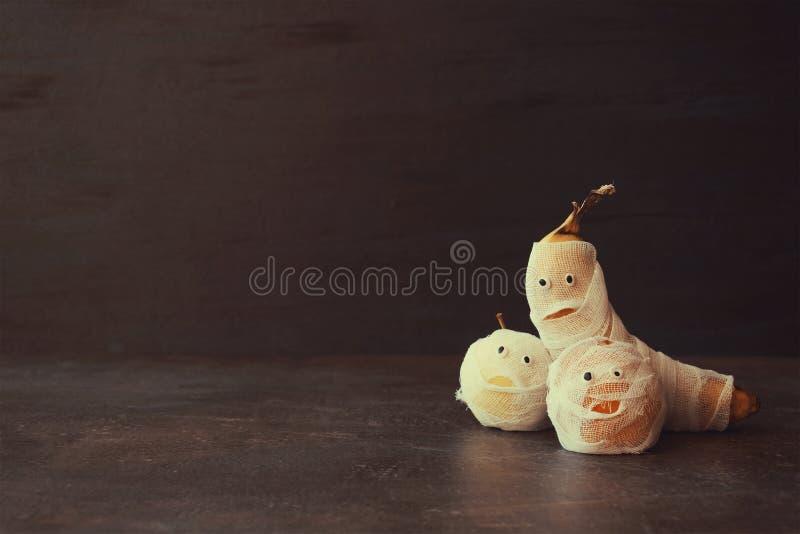 Halloween Fruit Mummy. Funny Scared orange, apple and banana wit stock image