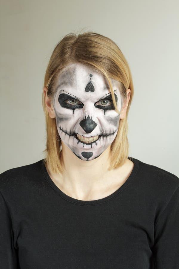 Halloween-gezicht het schilderen schedel stock afbeelding