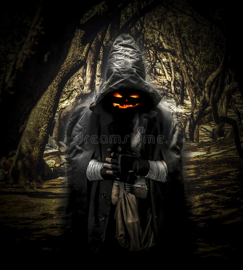 Halloween ghost in the forest stock photo