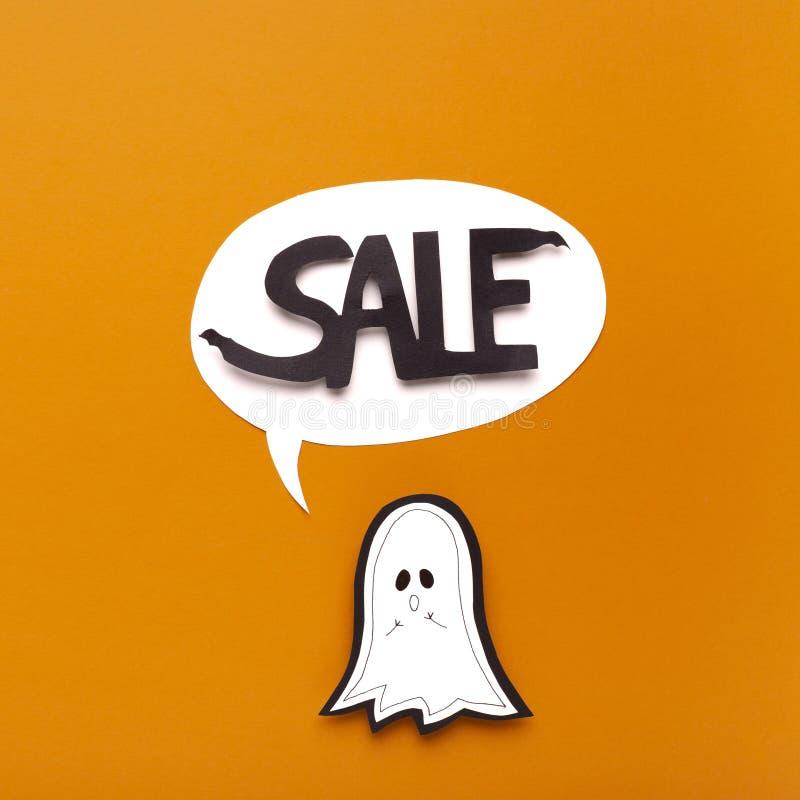 Halloween ghost saying word in speech bubble on orange stock image