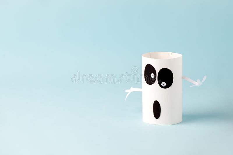 Halloween ghost, spook on blue for Halloween concept background. Paper crafts, DIY. Handcraft creative idea fron toilet tube,. Recycle concept, copy space stock photo