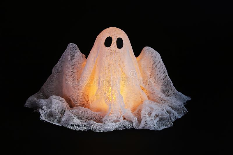 Halloween ghost of starch and gauze on black background. Gift idea, decor Halloween stock image