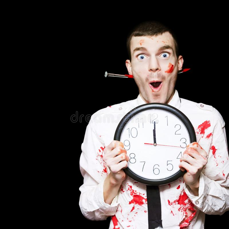 Download Halloween Ghoul Holding Clock Set To Midnight Stock Photo - Image: 26644768