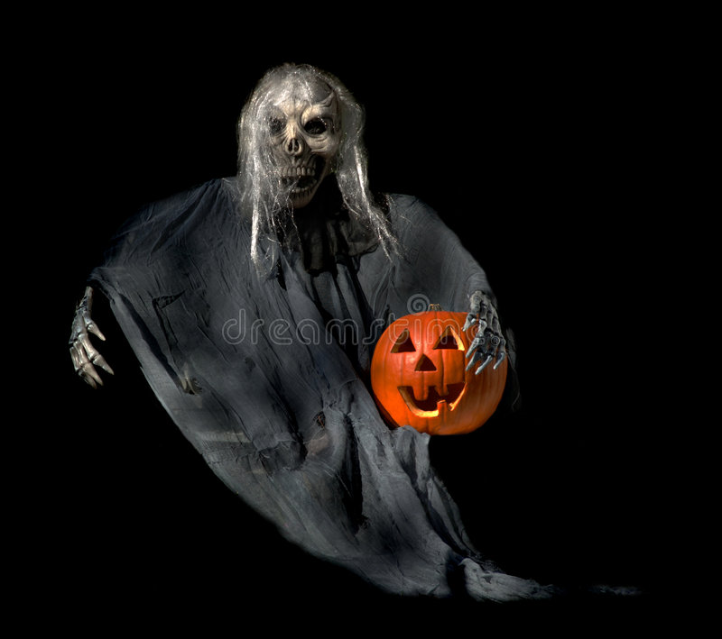 Halloween Ghoul with Jackolantern. Frightening Halloween ghoul with a jackolantern in his arm stock photos