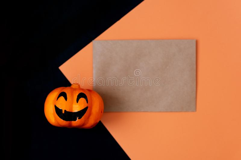 Halloween glitter pumpkin jack o lantern decor with funny faces stock images