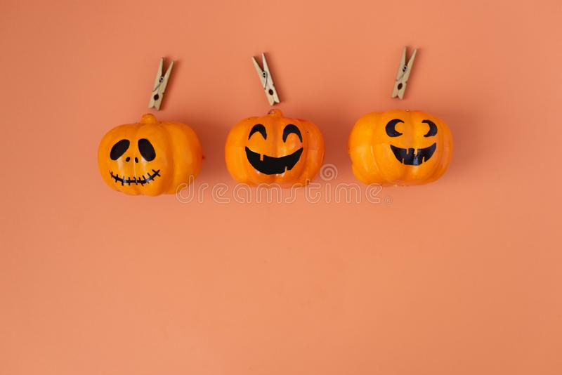 Halloween glitter pumpkin jack o lantern decor with funny faces royalty free stock photos