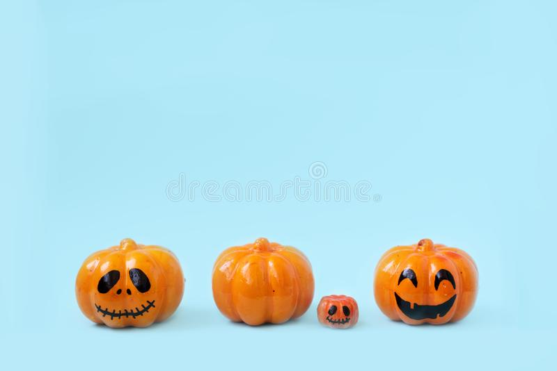 Halloween glitter pumpkin jack o lantern decor with funny faces royalty free stock images