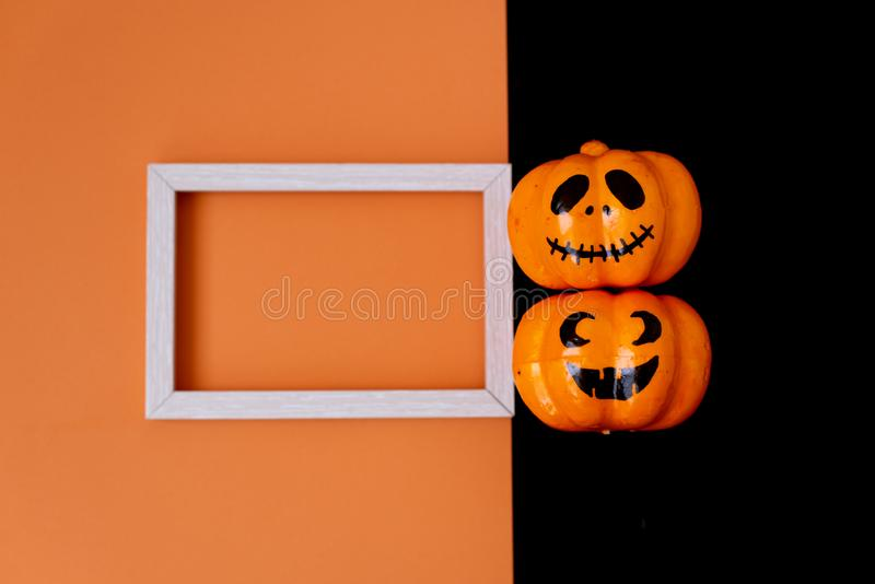 Halloween glitter pumpkin jack o lantern decor with funny faces stock photography