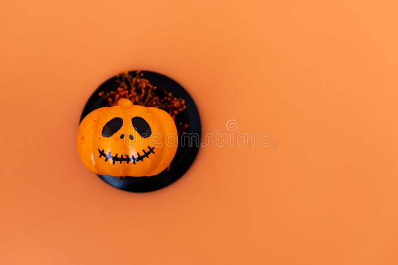 Halloween glitter pumpkin jack o lantern decor with funny faces stock photo