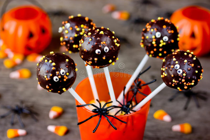 Halloween gourmet cake pops with holiday decor stock photo