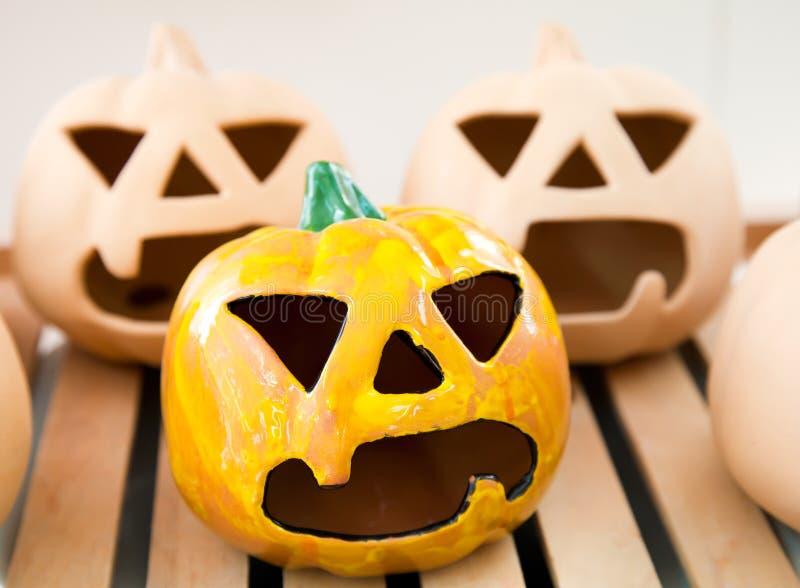Halloween handmade candlestick: pumpkin face. Ceramic handmade candlestick pumpkin face for Halloween stock photo