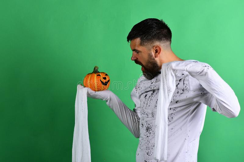 Halloween and happy holiday concept. Guy with beard royalty free stock photos