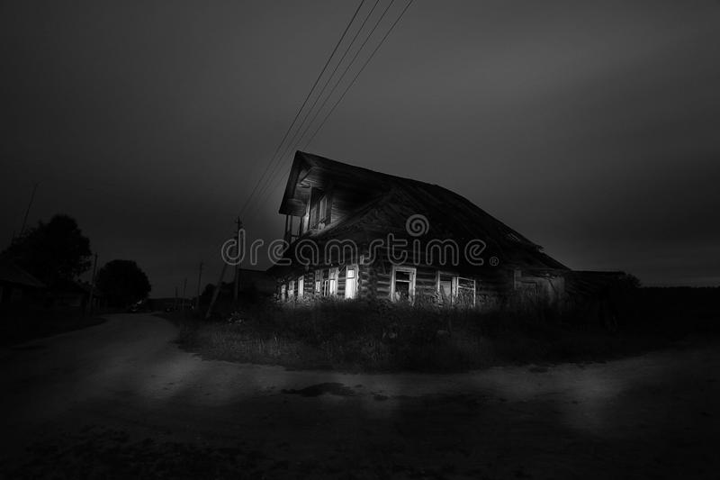 Halloween haunted house with ghosts royalty free stock images