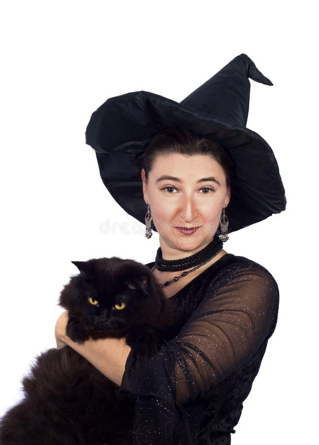 Halloween-Hexe mit schwarzer Katze lizenzfreies stockbild