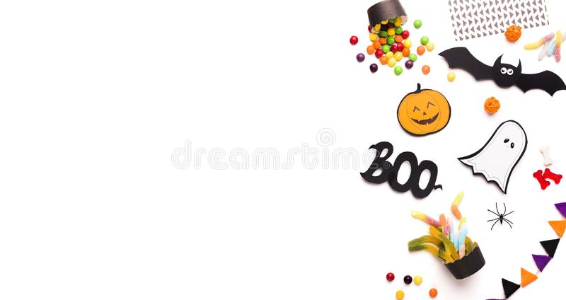 Halloween holiday background with flat lay of scary figures stock photo