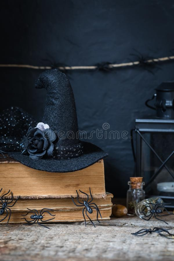 Halloween holiday background with lantern, spiders, old books, black witchhat royalty free stock image