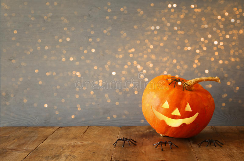 Halloween holiday concept. Cute pumpkin on wooden table royalty free stock image
