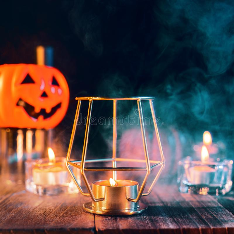 Free Halloween Holiday Concept Design Of Pumpkin, Candle, Spooky Decorations With Green Tone Smoke Around On A Dark Wooden Table, Close Royalty Free Stock Image - 158115166