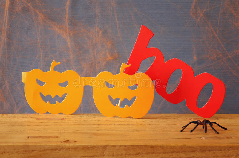 Halloween holiday concept. Funny paper pumpkin glasses stock photos