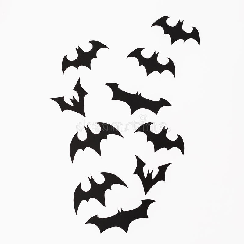 Halloween holiday concept. Handmade black bats on white background. Flat lay, top view. Halloween holiday concept. Handmade black bats on white background. Flat royalty free stock images