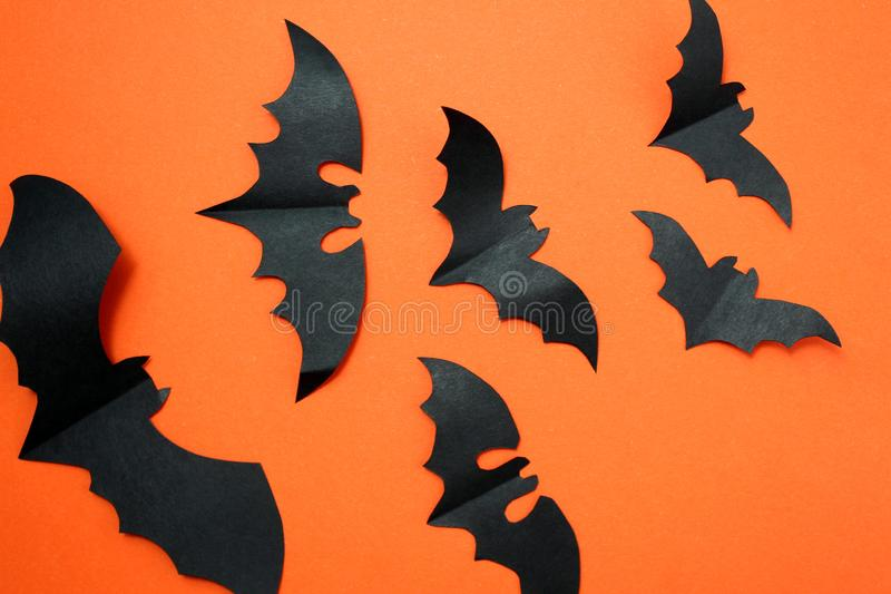 Halloween holiday concept with paper black bats. Halloween, creature, autumn, background picture, bats, black, character,, schematic diagram, creepy, decor stock photo