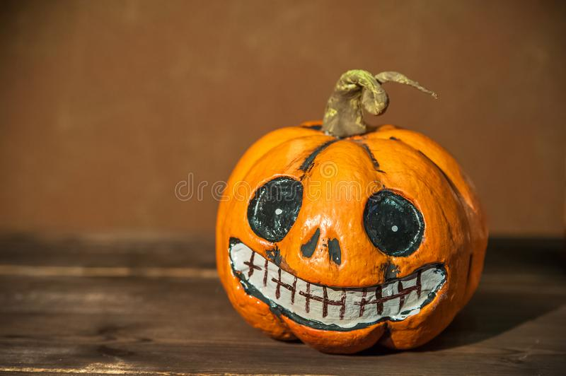Halloween holiday concept. Pumpkin with a face. Burning and extinguished candles. Background for text with pumpkin and smoke. Hall. Oween pumpkin head jack stock photo